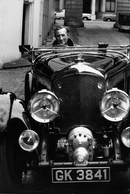 Ian Fleming gunning the motor in a friend's 4.5 litre Bentley, 1962